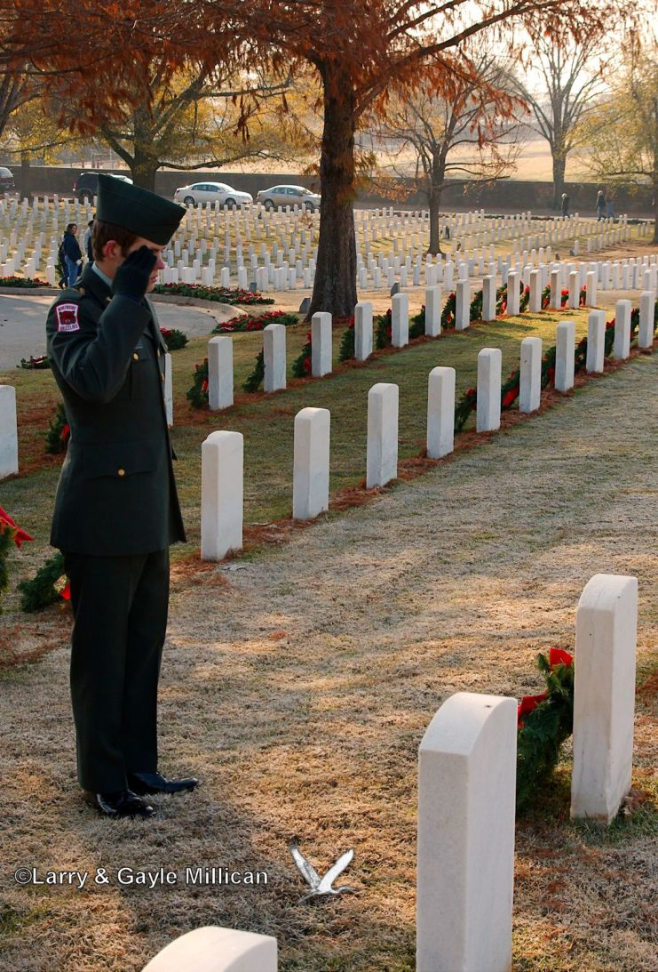 Jr ROTC trooper salutes the grave of an unknown