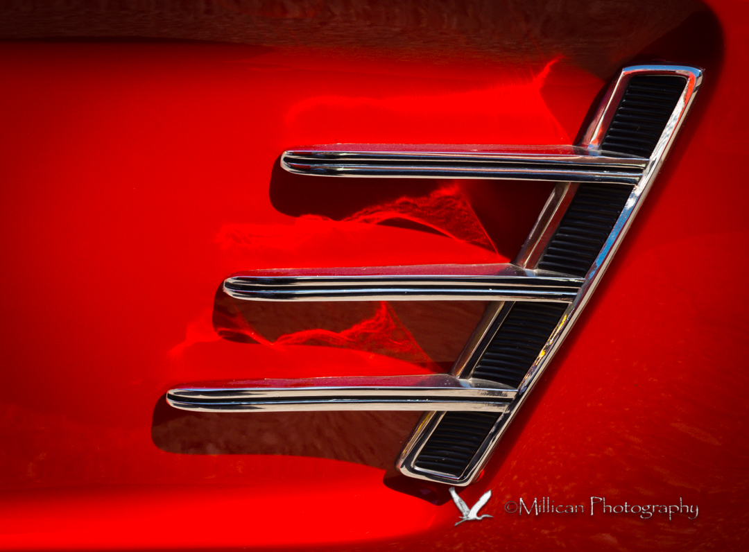 Side panel of a red 1966 Ford Mustang.  Yes, I had one like it...