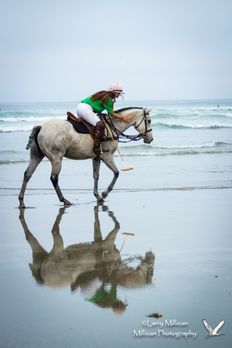 One of the Cal Poly Polo team takes a break from the action.  I really liked the reflection the wet sand gave us...